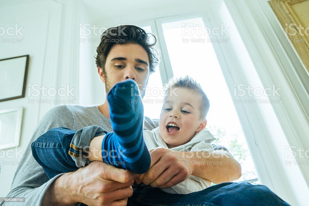 Father And Son Getting Ready In The Morning stock photo