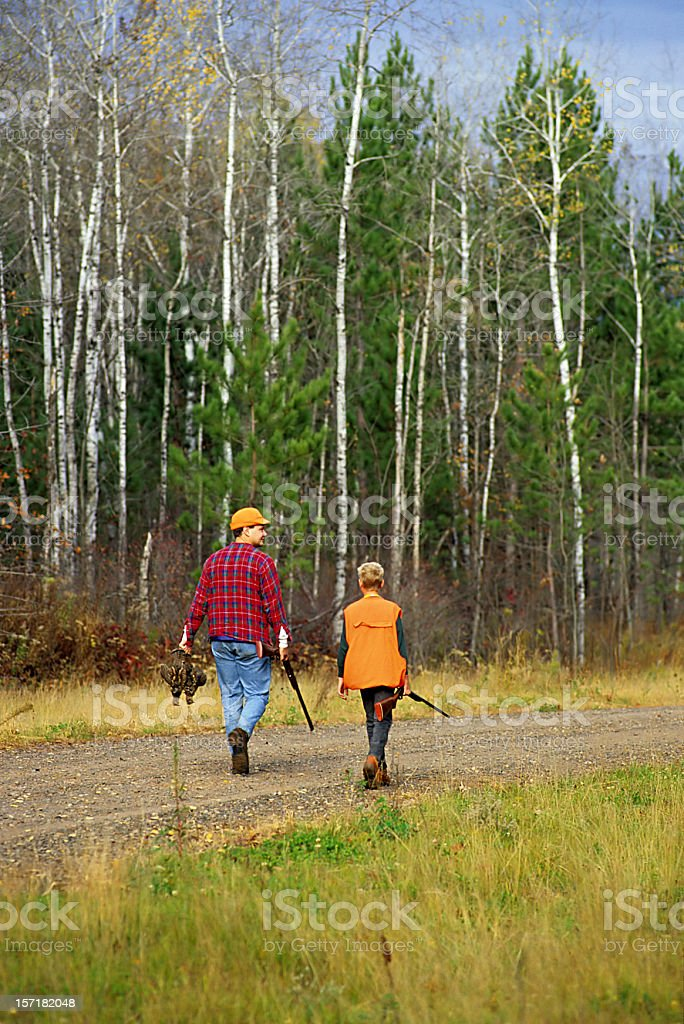 father and son go hunting royalty-free stock photo