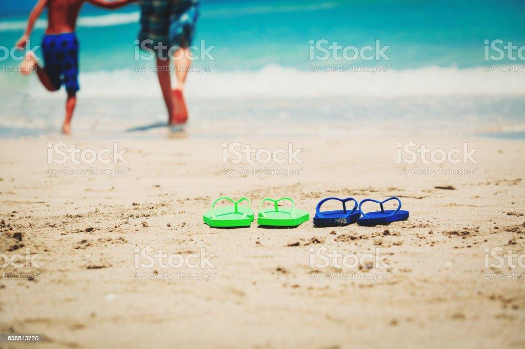 father and son go swim at beach - foto de acervo