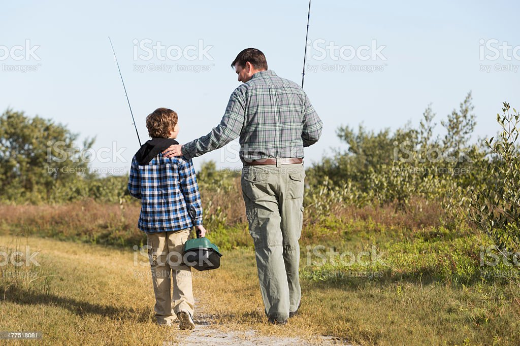 Father and son going fishing stock photo
