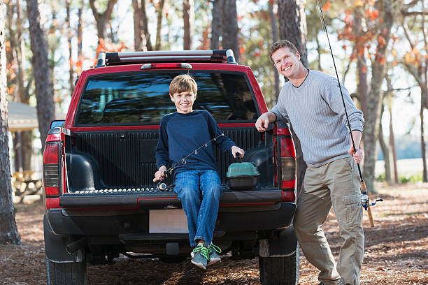 Father and son going on fishing trip stock photo