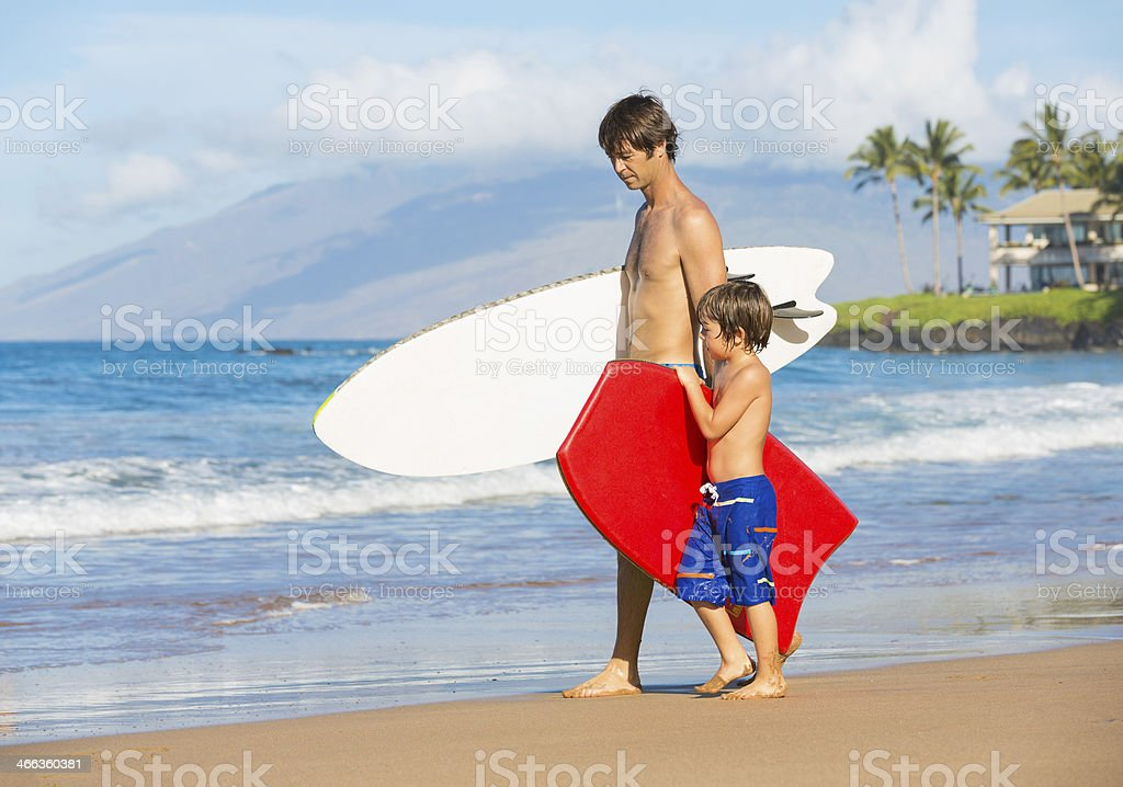 Father and Son Going Surfing Together on Tropical Beach stock photo