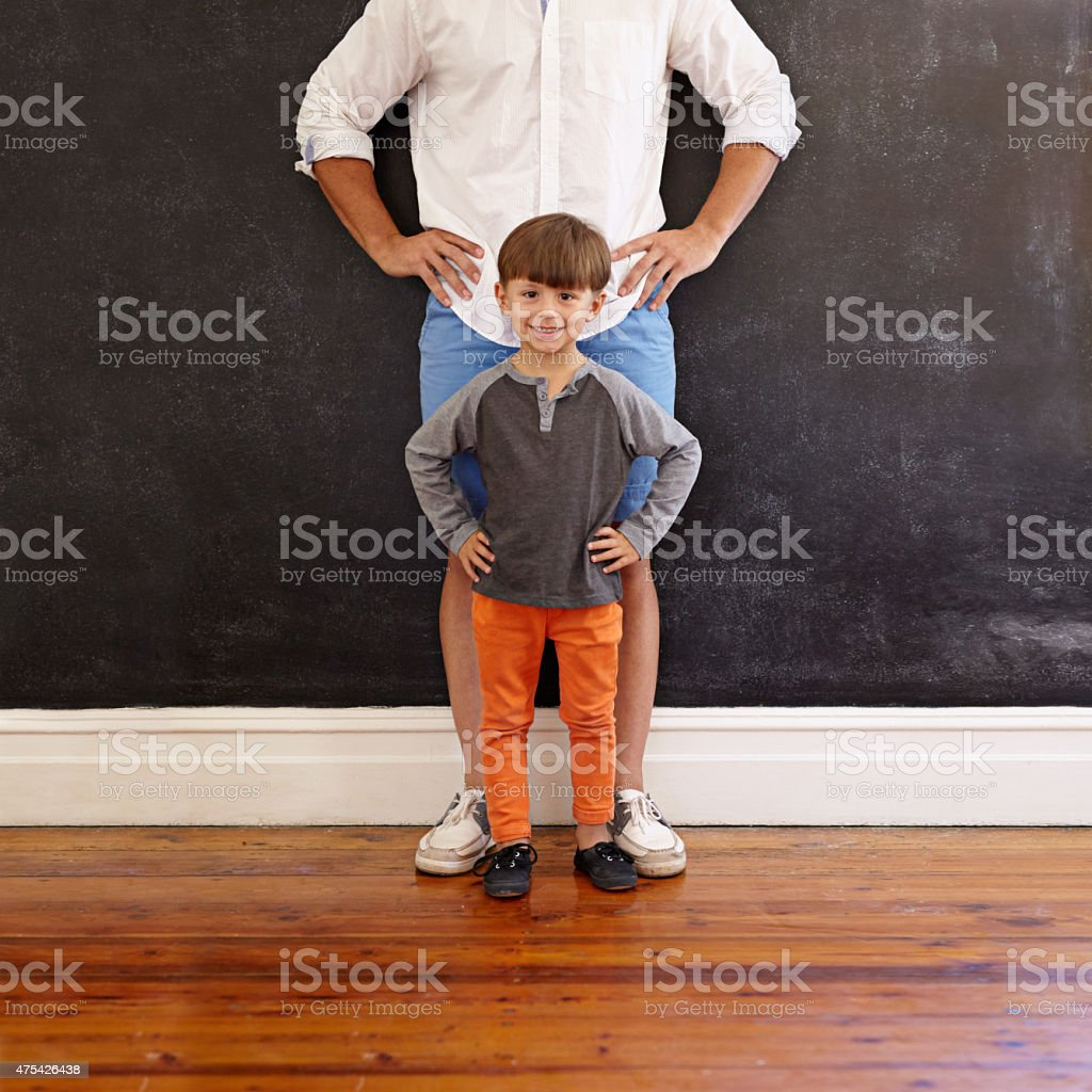 Father and son hands on waist stock photo