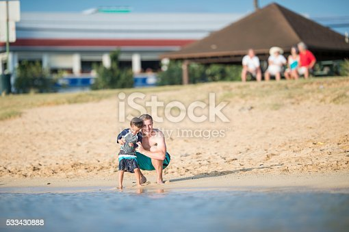 605742160 istock photo Father and Son Hanging Out at the Beach 533430888