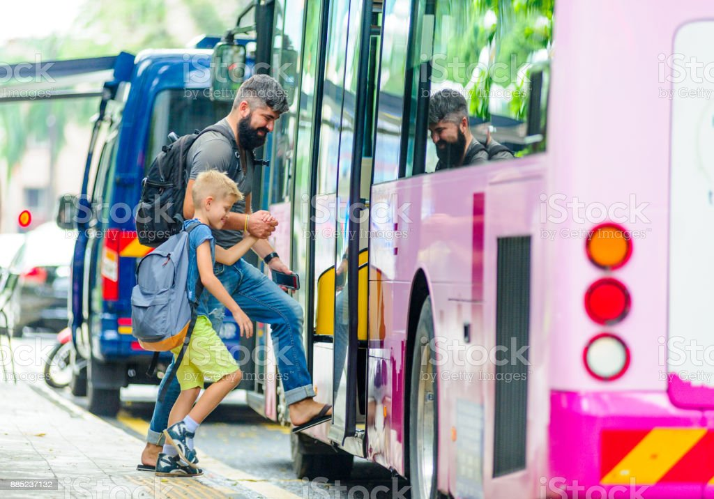 Father and son happy and excited together for the trip to Kuala Lumpur. Making a city tour. Holiday vacation, traveling abroad concept, copy space. stock photo