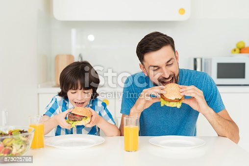istock Father and son have breakfast in the light kitchen. 873025768