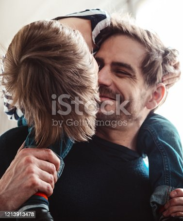 649431568 istock photo father and son have fun together 1213913478