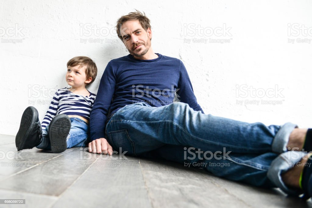 father and son have fun together stock photo
