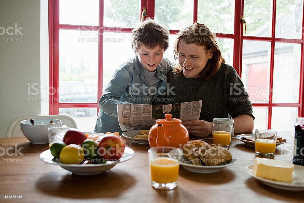 Father and son having breakfast royalty-free stock photo