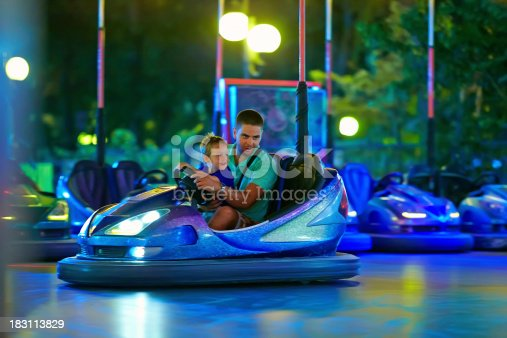 496487362istockphoto father and son having fun, driving electric toy car 183113829