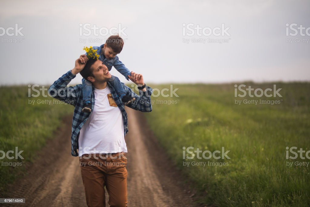 Father and son having fun on the countryside royalty-free stock photo