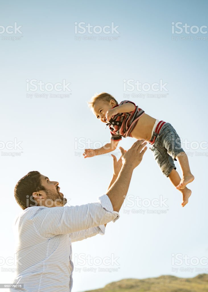 Father and son having fun outdoors stock photo