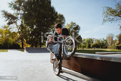 860036242 istock photo Father and Son havinh fun in skate park 1176552304