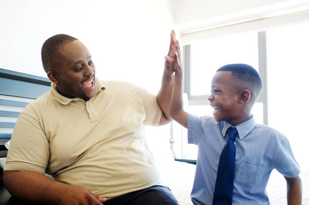Father and son high five stock photo