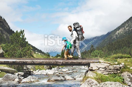 Father and son hiking together in mountains