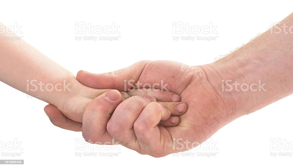 father and son holding hand royalty-free stock photo