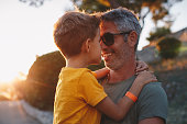 istock Father and son hugging outdoors, shallow depth of field 1268453207