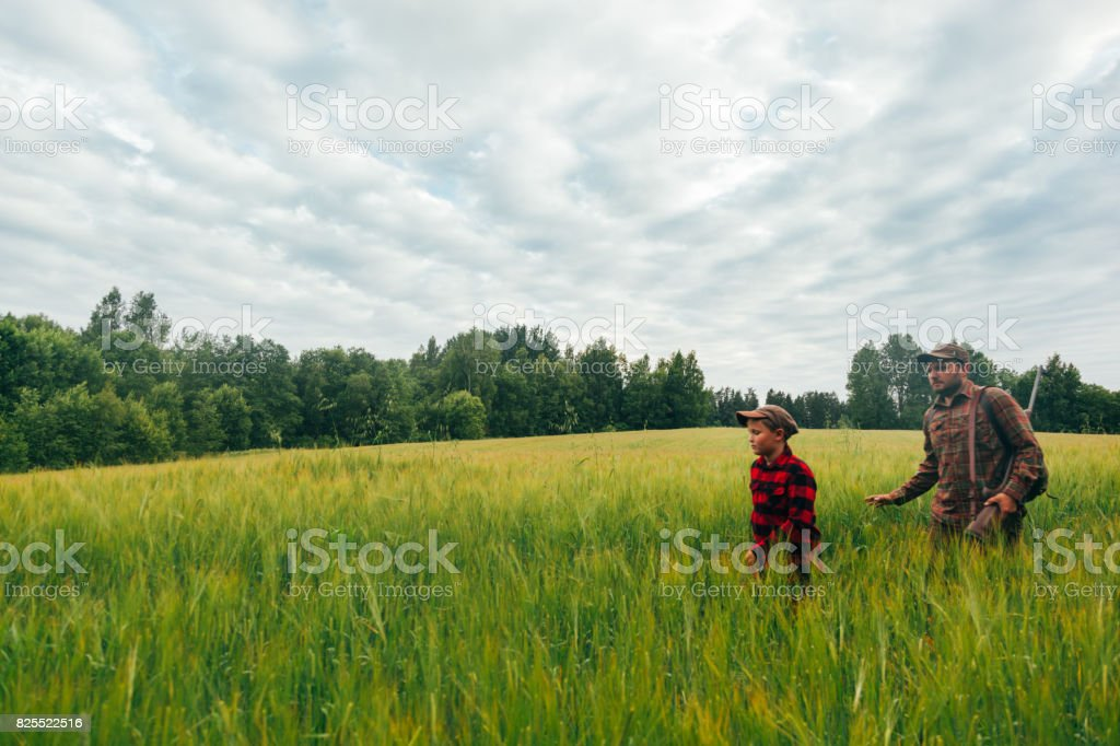 Father and Son hunting for boar stock photo