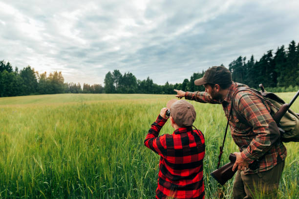 Father and Son hunting for boar Real hunter, northern Europe hunter stock pictures, royalty-free photos & images