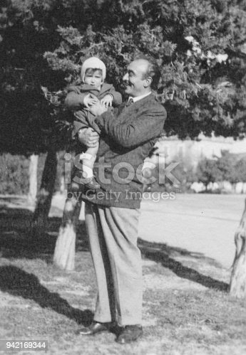 Father and son in 1949, black and white photography