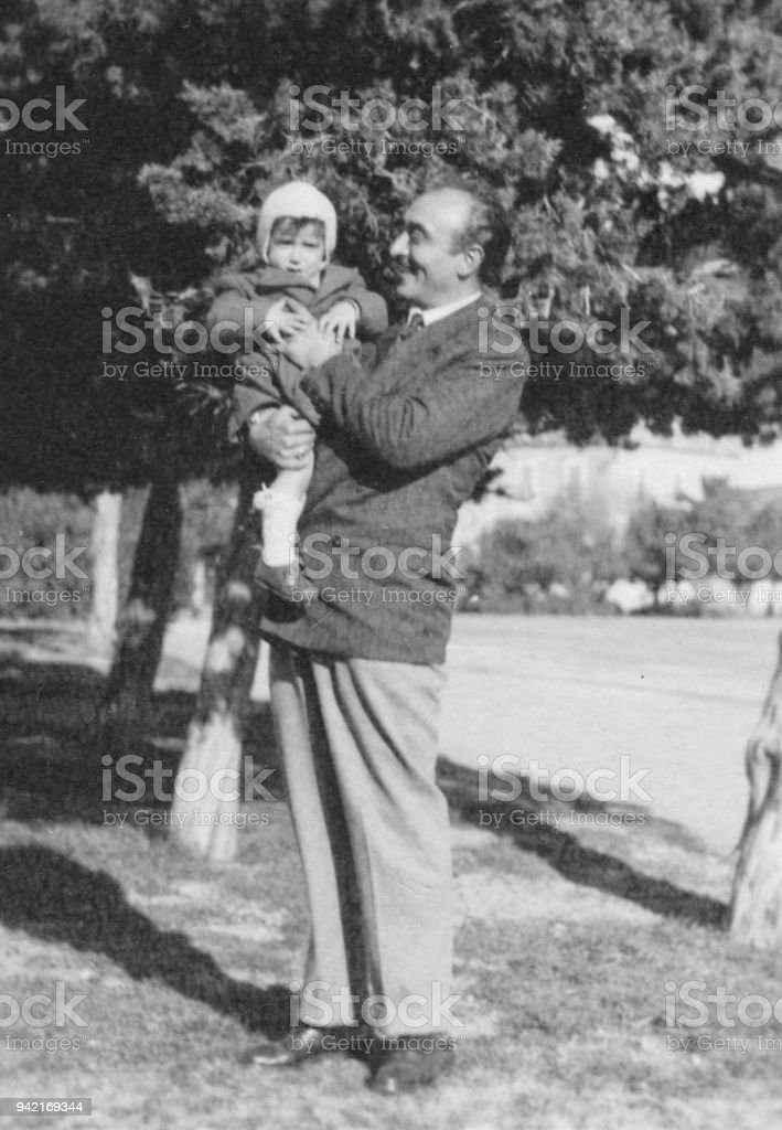 Father and son in 1949 stock photo