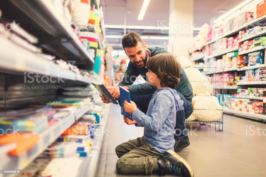 Father and Son In A Supermarket. stock photo