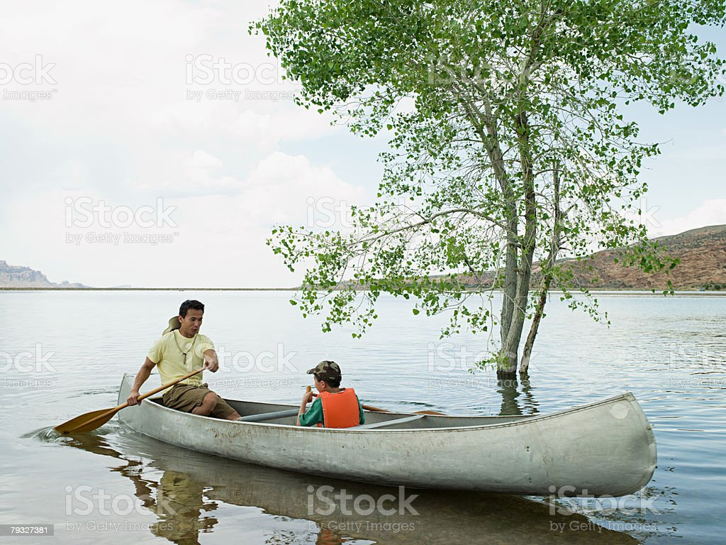 Father and son in canoe royalty-free stock photo