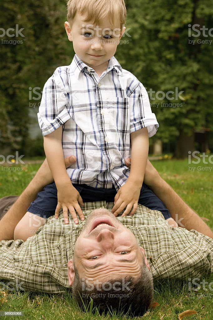 Father and son in garden royalty-free stock photo