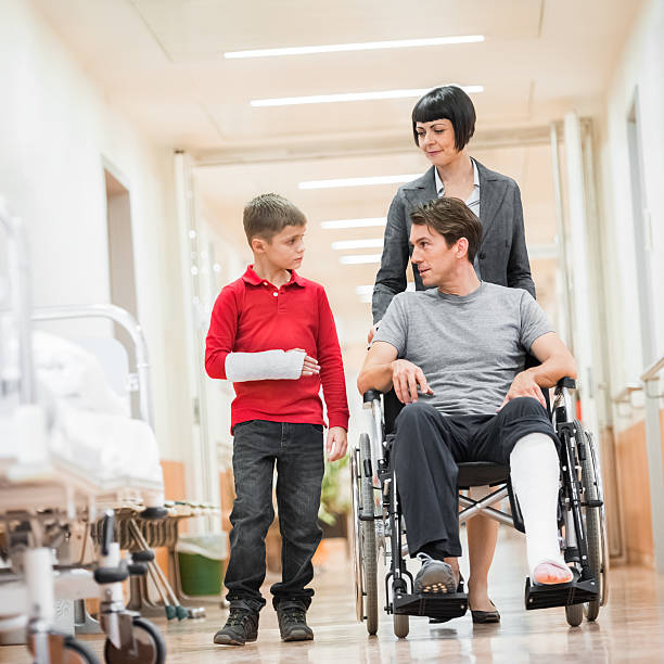 father and son in hospital - broken leg stock photos and pictures