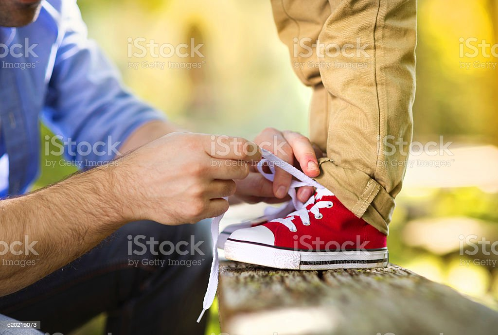 Father and son in nature stock photo
