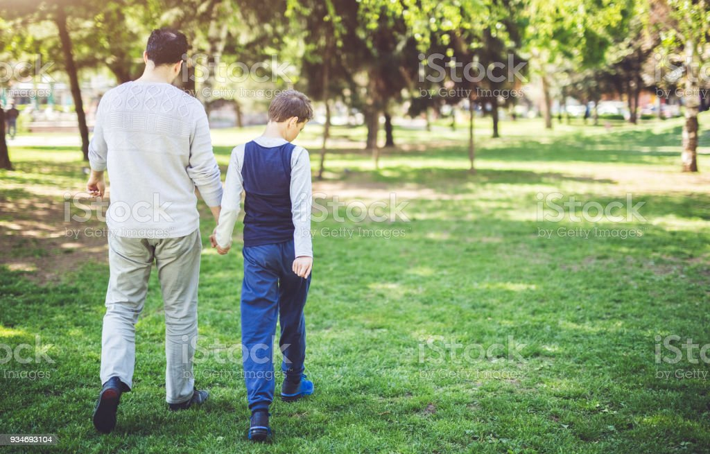 Father And Son In Park stock photo