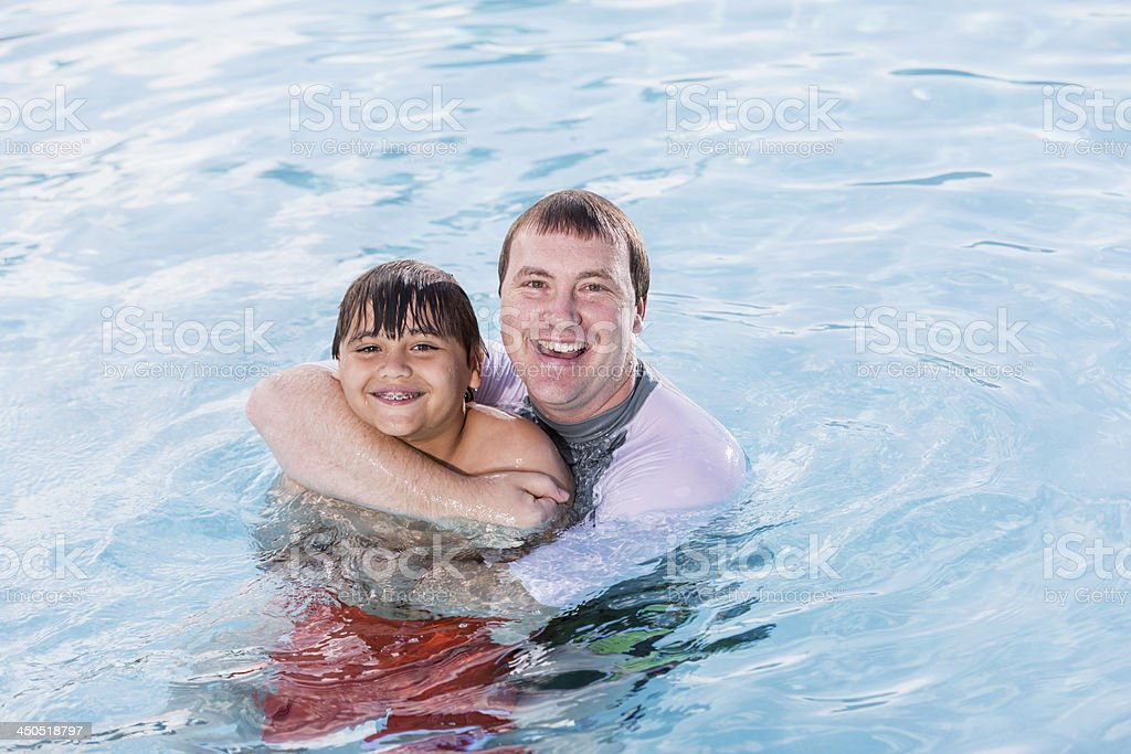 Father and son in pool stock photo