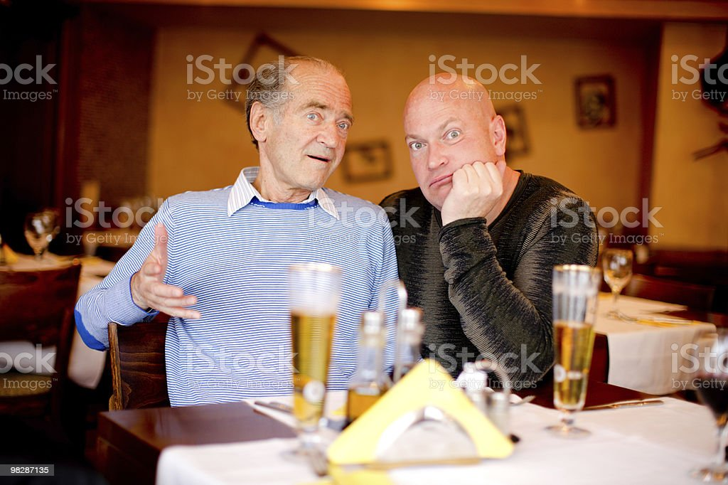Father and son in restaurant royalty-free stock photo