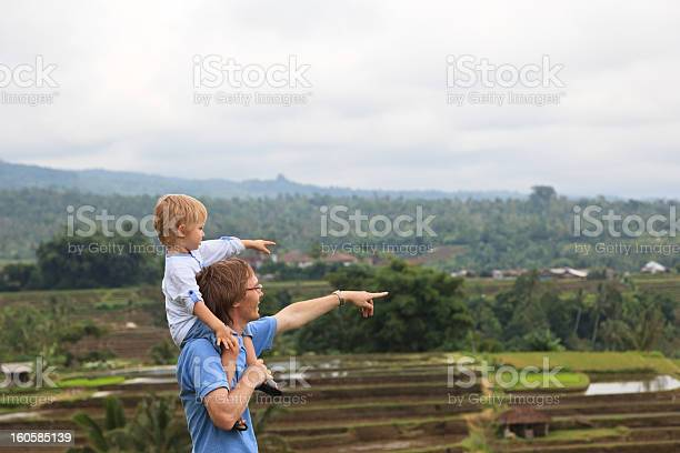 father and son in rice field of Bali