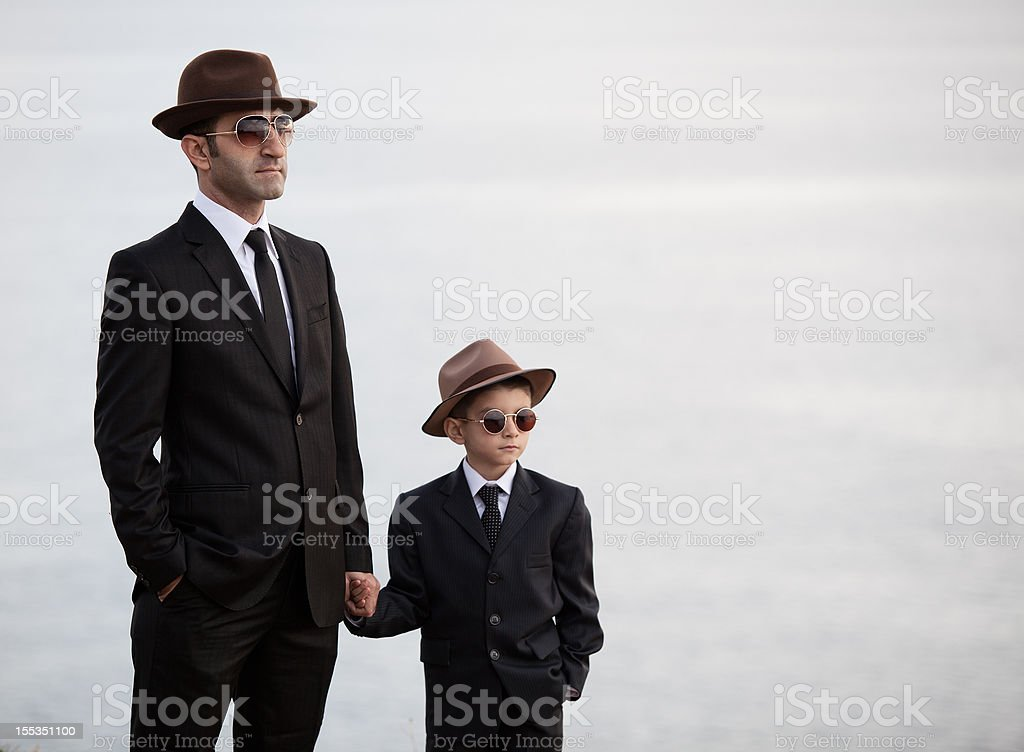 Father and son in similar clothes royalty-free stock photo