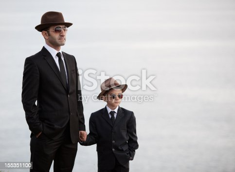 Father And Son In Similar Clothes Stock Photo & More Pictures of 6-7 Years