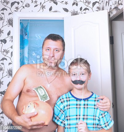 istock Father and son in the bathroom. Concept movember. 1053372252
