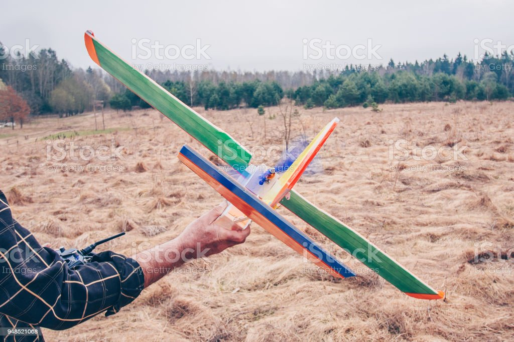 Father and son launches radio-controlled model of the aircraft stock photo