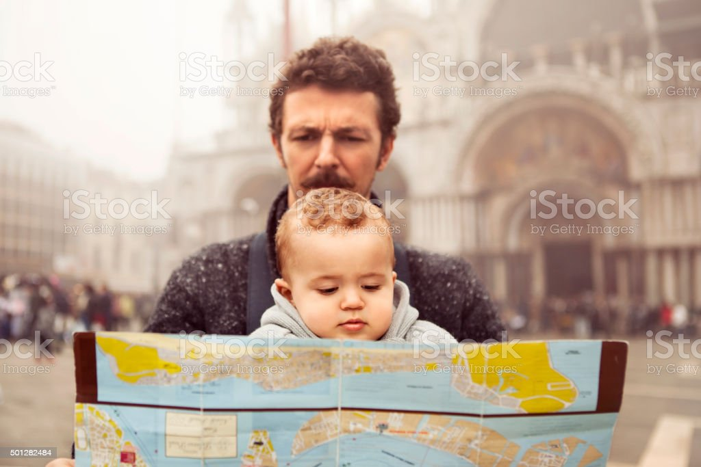 Father and son looking at a map in Venice royalty-free stock photo