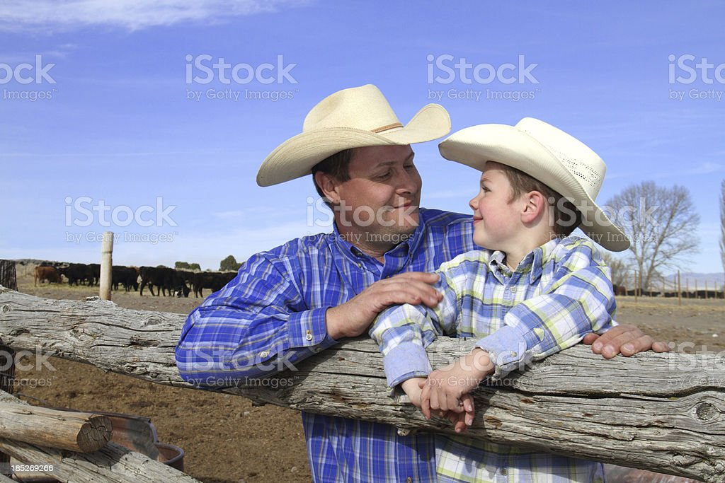 Father and Son Looking at eachother on their ranch royalty-free stock photo
