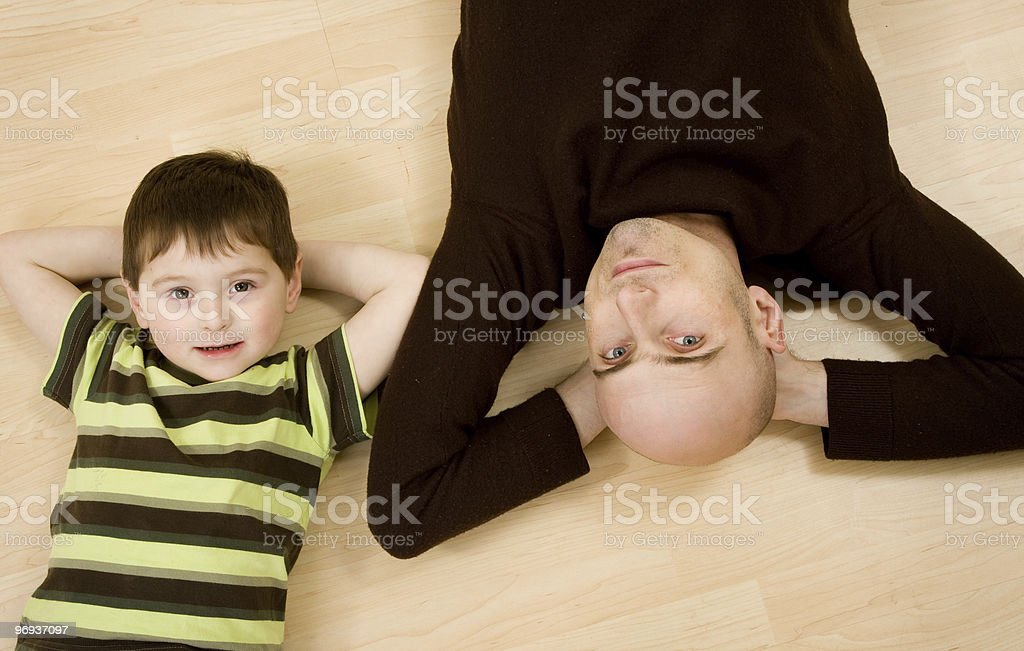 Father and son lying down royalty-free stock photo