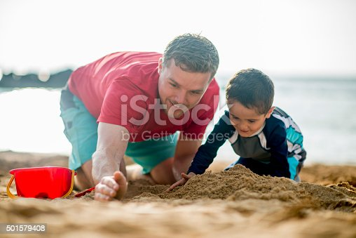 605742160 istock photo Father and Son Making a Sandcastle 501579408