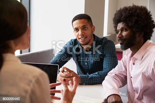 istock Father And Son Meeting With Female Teacher 600055440