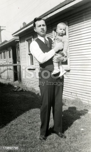 Father holding his infant son in 1937