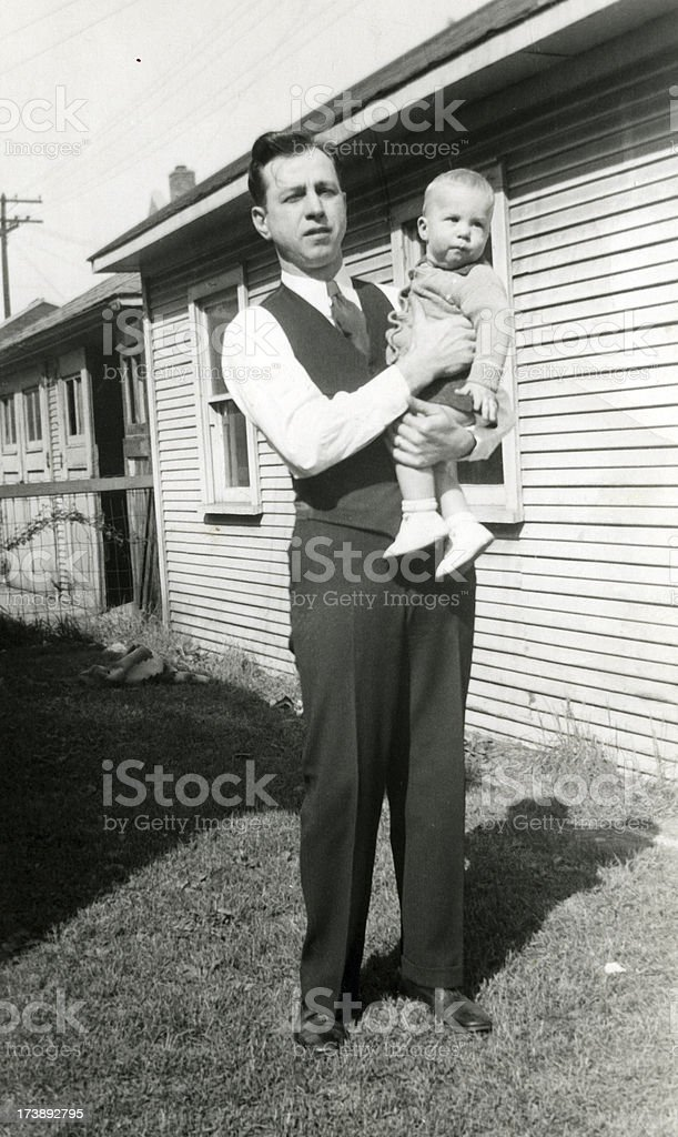 Father and son of the 30's stock photo