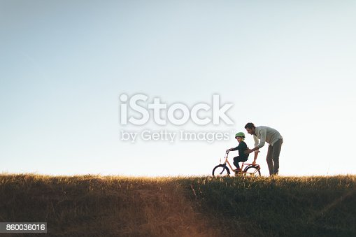 860036242 istock photo Father and son on a bicycle lane 860036016