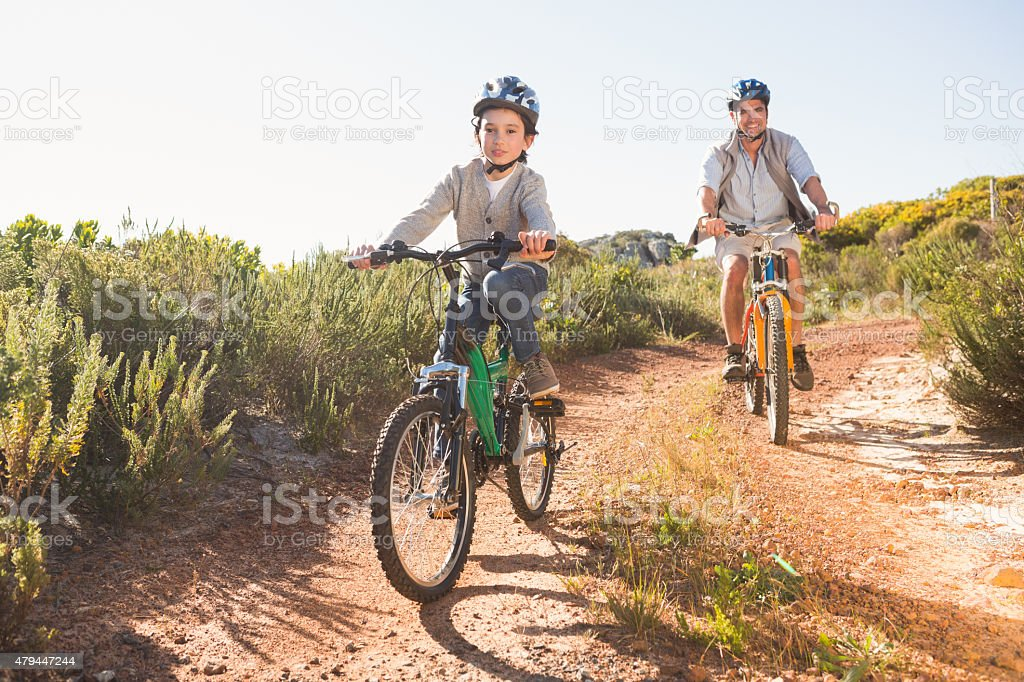 Father and son on a bike ride stock photo
