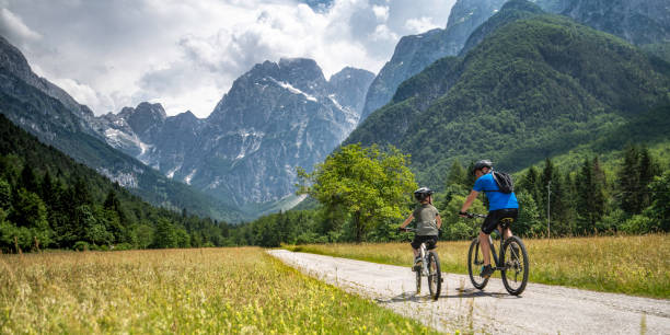 Father and son on a cycling trip to the mountains