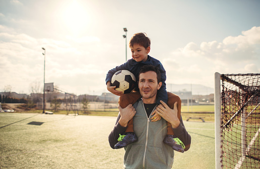 Father and son on a soccer court