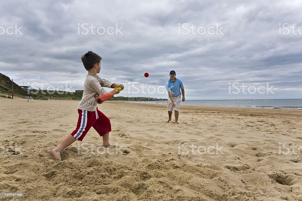 Father and son on beach stock photo